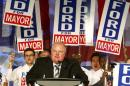 Toronto Mayor Rob Ford addresses supporters on the podium during his campaign launch party in Toronto