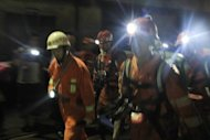 Rescuers head to search for survivers after a gas explosion at a coal mine in Panzhihua, China's Sichuan province, on August 29. The death toll from the explosion has risen to 37, with another 10 people still trapped, the official Xinhua news agency said on Friday