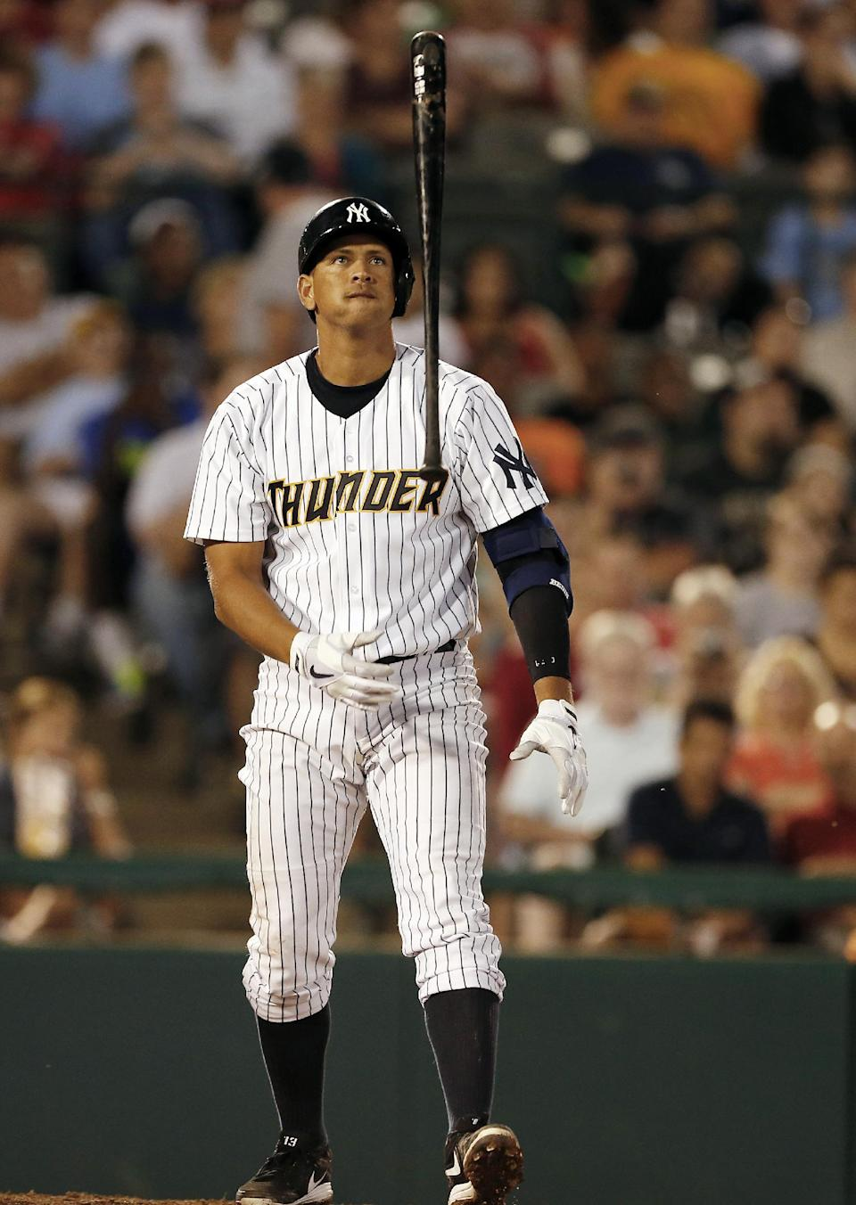 New York Yankees' Alex Rodriguez flips his bat after missing a pitch in the fifth inning of a Class AA baseball game with the Trenton Thunder against the Reading Phillies Saturday, Aug. 3, 2013, in Trenton, N.J. (AP Photo/Rich Schultz)