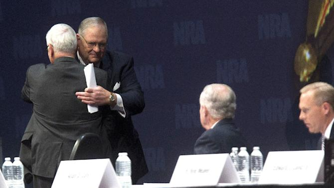 """NRA President David A. Keene, right, gives first vice president, Jim Porter a hug during the NRA Annual Meeting of Members at the NRA Annual Meeting of Members at the National Rifle Association's 142 Annual Meetings and Exhibits in the George R. Brown Convention Center Saturday, May 4, 2013, in Houston. Wayne LaPierre, the public face of the National Rifle Association implored members Saturday to never give up their weapons in the wake of recent gun control efforts in Congress that he said will """"destroy us and every ounce of our freedom."""" (AP Photo/Houston Chronicle, Johnny Hanson)"""