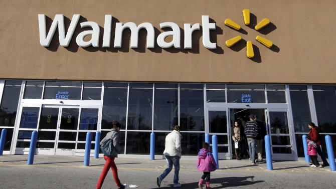 FILE - In this Feb. 20, 2012, file photo, customers walk into and out of a Wal-Mart store in Methuen, Mass.  Wal-Mart Stores Inc. reported a 10.1 percent increase in first-quarter profit that beat Wall Street estimates, reported Thursday, May 17, 2012. The world's largest retailer also offered an upbeat profit outlook for the current quarter.  (AP Photo/Elise Amendola, File)