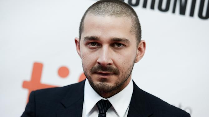 "FILE - In this Sept. 15, 2015, file photo, Actor Shia LaBeouf attends a premiere for ""Man Down"" on day 6 of the Toronto International Film Festival at Roy Thomson Hall in Toronto. The actor was arrested and charged with public intoxication after an incident in Austin, Texas. Jail records show LaBeouf was booked Friday, Oct. 9, 2015, night into the Travis County Jail and released on his own recognizance. (Photo by Richard Shotwell/Invision/AP, File)"