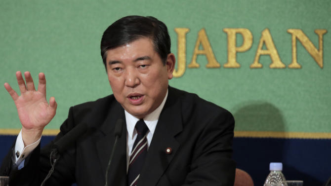 """In this Sept. 15, 2012 photo, Japan's leading opposition Liberal Democratic Party presidential candidate Shigeru Ishiba speaks as he attends a debate with his rivals at the Japan National Press Club in Tokyo. Four lawmakers vying for leadership of Japan's main opposition party have promised to protect Japan's control of islands at the center of a territorial furor with China. Former defense chief Shigeru Ishiba says that """"losing a piece of the territory eventually means losing the whole country.""""  (AP Photo/Itsuo Inouye)"""