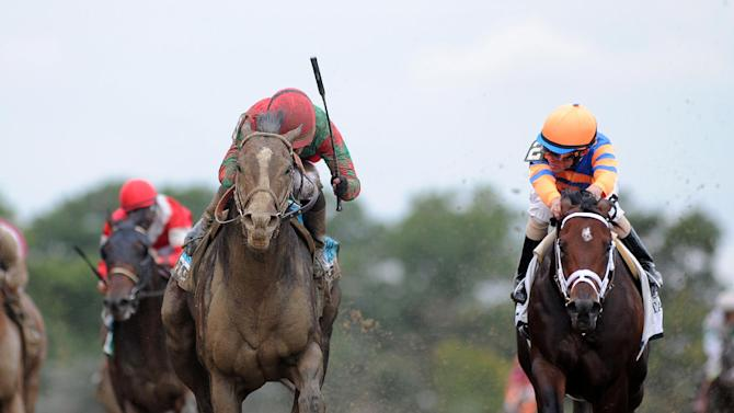 This photo released by the New York Racing Association shows Flat Out, left, capturing The Jockey Club Gold Cup for the second year in a row at Belmont Park, in New York Saturday, Sept. 29, 2012. (AP Photo/New York Racing Association, Adam Coglianese)