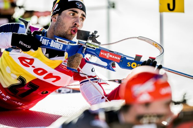 Martin Fourcade of France prepares to shoot during the IBU Biathlon World Cup sprint in Holmenkollen in Oslo