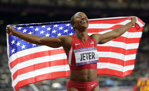 United States' Carmelita Jeter celebrates winning bronze in the women's 200-meter final during the athletics in the Olympic Stadium at the 2012 Summer Olympics, London, Wednesday, Aug. 8, 2012. (AP Photo/David J. Phillip)
