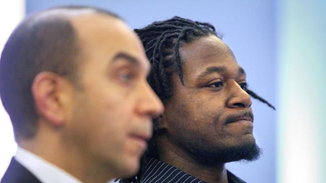 """Cincinnati Bengals cornerback Adam """"Pacman"""" Jones, right, appears in Hamilton County Municipal Court in Cincinnati with his lawyer, Ed Perry, Wednesday, Jan. 18, 2012. Jones pleaded guilty to a misdemeanor charge of disorderly conduct.  Jones was ordered to serve a year of probation, complete 50 hours of community service and pay a $250 fine plus court costs.  (AP Photo/The Enquirer, Carrie Cochran) NO SALES"""