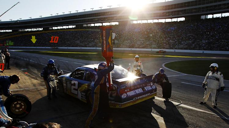 Brad Keselowski (2) has his car serviced during a NASCAR Sprint Cup Series auto race at Texas Motor Speedway, Sunday, Nov. 4, 2012, in Fort Worth, Texas. (AP Photo/Tim Sharp)