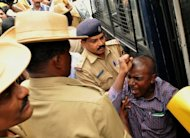 An Indian activist from the 'Campaign Against Child Labour' is arrested during a demonstration outside the French consulate in Bangalore, on June 18, 2012. The Indian wife of a French consular official charged with raping their daughter has demanded a meeting with Francois Hollande, presenting the French president with a thorny diplomatic dilemma on his first state visit to India