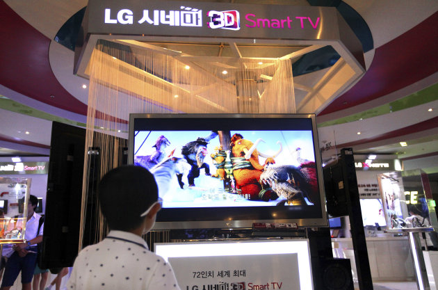 A boy watches a 3D animation movie at a display for LG Electronics products inside the COEX Mall in Seoul, South Korea, Wednesday, July 25, 2012. LG Electronics reported a lower quarterly profit as its mobile phone division sank to a loss, underlining the challenges for its smartphone business as it struggles with competition from Apple and Samsung. (AP Photo/Hye Soo Nah)