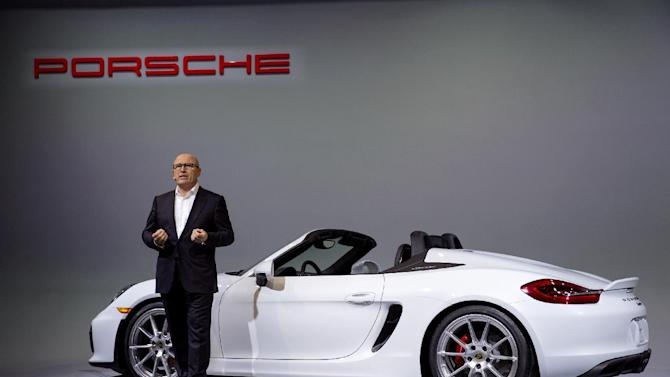 Bernhard Maier, member of the Executive Board of Management with Porsche, speaks during the debut of the new Porsche Boxster Spyder at the New York International Auto Show, Tuesday, March 31, 2015. (AP Photo/Craig Ruttle)