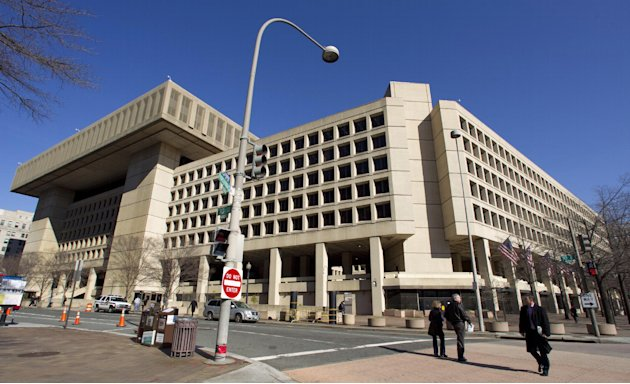 FILE - This Feb. 3, 2012 file photo shows the Federal Bureau of Investigation (FBI) headquarters in Washington. Trying to ratchet up pressure on Congress, the White House on Friday detailed what it sa