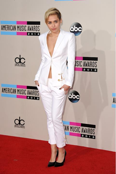 FILE - This Nov. 24, 2013 file photo shows Miley Cyrus at the American Music Awards in Los Angeles. It must be mentioned that Miley Cyrus embodied more than one fashion trend this year. Is Cyrus becom