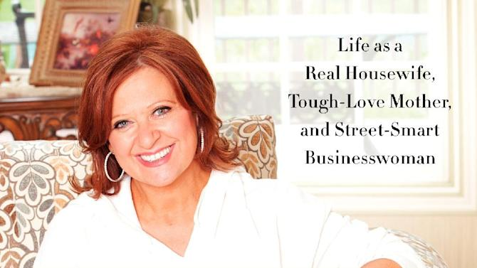 "This book cover image released by It Books shows ""Let Me Tell You Something: Life as a Real Housewife, Tough-Love Mother, and Street-Smart Businesswoman,"" by Caroline Manzo.  Manzo's book was released on Tuesday, March 26. (AP Photo/It Books)"