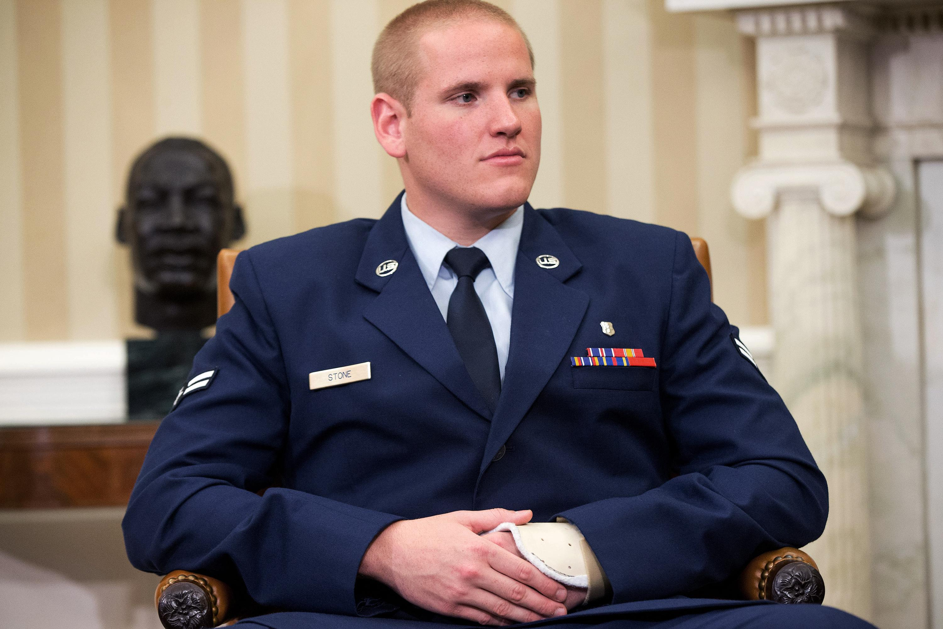 The Latest: Video shows knife fight that injured US airman
