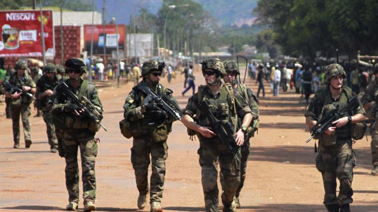 French soldiers patrol on foot in Bangui
