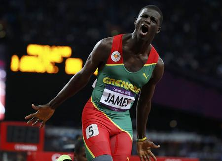      Grenada's Kirani James celebrates after winning the men's 400m final at the London 2012 Olympic Games at the Olympic Stadium August 6, 2012. 
