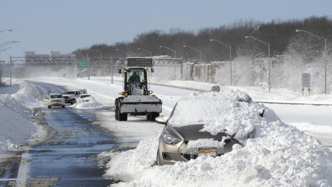 Abandoned cars on the Long Island Expressway after a snow storm on Saturday, Feb. 9, 2013 in Islandia, N.Y. (AP Photo/Kathy Kmonicek)