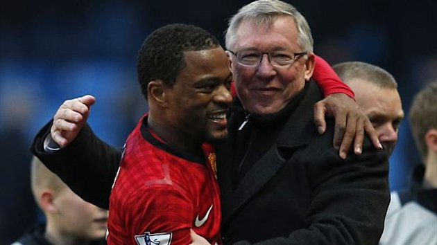 Patrice Evra hugs Sir Alex Ferguson (Reuters)