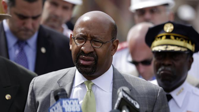 Mayor Michael Nutter speaks during a news conference in the aftermath of a building collapse, Thursday, June 6, 2013, in Philadelphia. On Wednesday, the building under demolition collapsed onto a neighboring thrift store, killing six people and injuring 14, including one who was pulled from the debris nearly 13 hours later. (AP Photo/Matt Rourke)