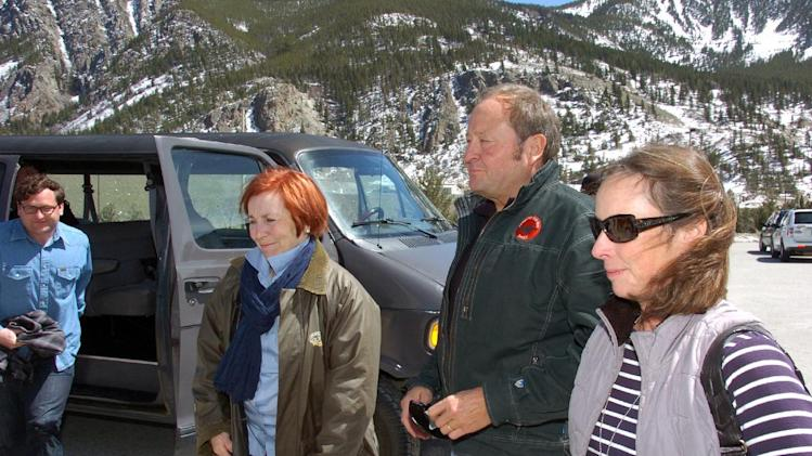 Former Montana Gov. Brian Schweitzer, third from left, his wife, Nancy, far right, and board member Patrice Merrin, left, arrive at the Stillwater Mining Co. precious metals mine  to attend the company's annual meeting near Nye, Mont. on Thursday, May  2, 2013. Former Gov. Schweitzer and a team of dissident investors took four seats on the company's board after waging takeover attempt. (AP Photo/Matthew Brown)