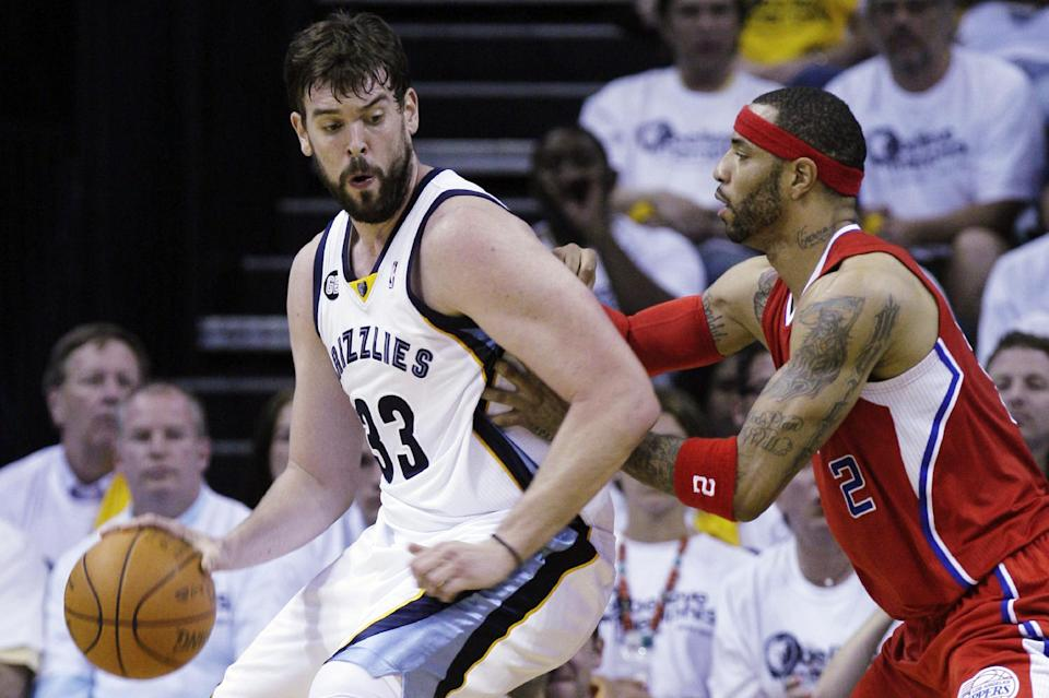 Memphis Grizzlies' Marc Gasol (33), of Spain, is defended by Los Angeles Clippers' Kenyon Martin (2) during the first half in Game 1 of a first-round NBA basketball playoff series, Sunday, April 29, 2012, in Memphis, Tenn. (AP Photo/Danny Johnston)