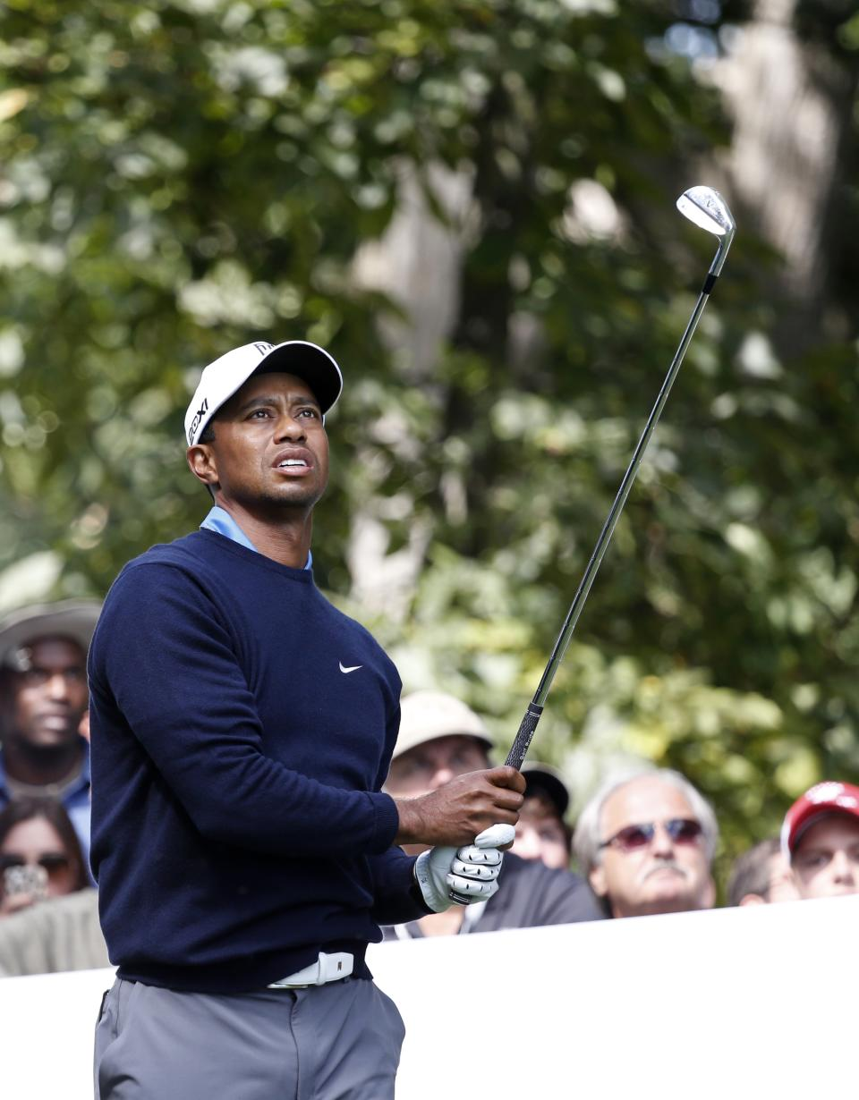 Tiger Woods watches his tee shot on the second hole during the second round of the BMW Championship golf tournament at Conway Farms Golf Club in Lake Forest, Ill., Friday, Sept. 13, 2013. (AP Photo/Charles Rex Arbogast)