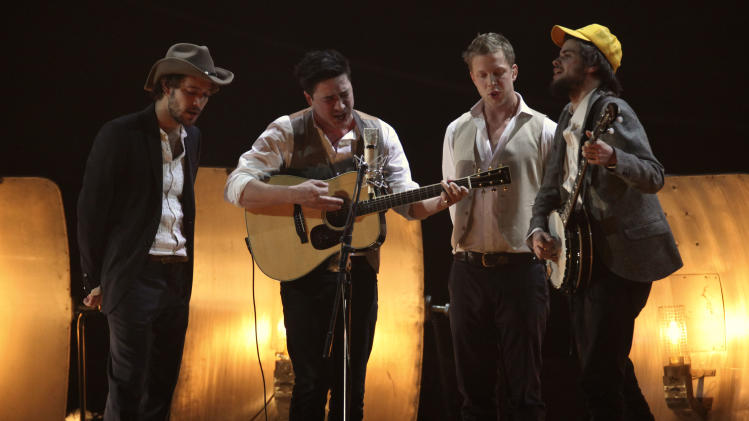 FILE - In this Tues., Feb. 15, 2011 file photo, Mumford and Sons perform on stage for the Brit Awards 2011 at The O2 Arena in London. Mumford and Sons is among the six nominees with a leading six nods for the 55th annual Grammy Awards, announced Wednesday night, Dec. 5, 2012, at Bridgestone Arena in Nashville, Tenn. (AP Photo/Joel Ryan, File)
