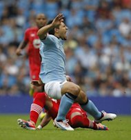 Manchester City's Sergio Aguero (R) is seen being injured as Southampton's Nathaniel Clyne tackles him during their English Premier League match at the City of Manchester Stadium in Manchester, on August 19. Man City will hope to welcome Aguero for the tricky trip to an always obdurate Stoke on Saturday