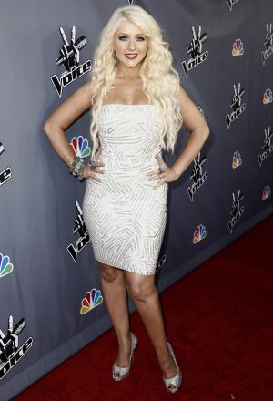"FILE - In this June 29, 2011 file photo, singer Christina Aguilera, poses for photographers after finale of ""The Voice"" in Burbank, Calif. Aguilera has been nominated for three ALMA Awards; for favorite female music artist, favorite movie actress in a comedy or musical for her role in ""Burlesque,"" and favorite TV reality personality for ""The Voice.""  The ALMA Awards will air on Sept. 16 on NBC.  (AP Photo/Matt Sayles, file)"