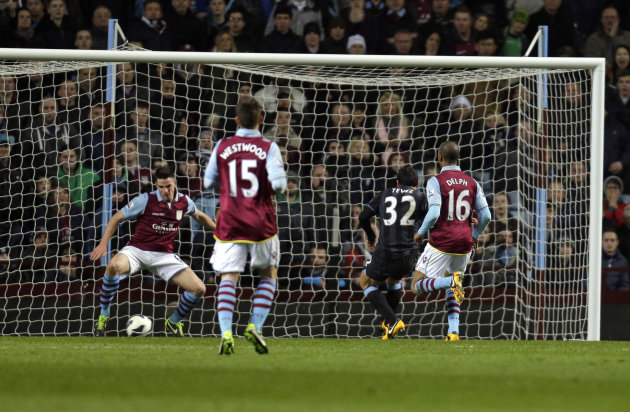 Manchester City's Carlos Tevez, no 32, shoots to score against Aston Villa during their English Premier League soccer match at the Villa Park ground in Birmingham, England, Monday, March 4, 2013. (AP