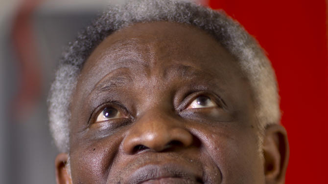 ADD FEB. 12 - Ghanaian Cardinal Peter Kodwo Appiah Turkson looks up during an interview with the Associated Press, in Rome, Tuesday, Feb. 12, 2013. One of Africa's brightest hopes to be the next pope, Ghanaian Cardinal Turkson, says the time is right for a pontiff from the developing world. (AP Photo/Domenico Stinellis)