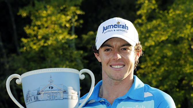Rory McIlroy, of Northern Ireland, holds the trophy after winning the Deutsche Bank Championship PGA golf tournament at TPC Boston in Norton, Mass., Monday, Sept. 3, 2012. (AP Photo/Michael Dwyer)