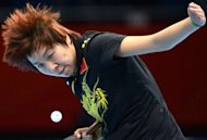China's Li Xiaoxia returns the ball toward Japan's Ai Fukuhara during the 2012 London Olympic Games table tennis women's team gold medal matches at the ExCeL arena in London. China's women retained their Olympic table tennis team title on Tuesday when they overcame Japan 3-0 in a one-sided final