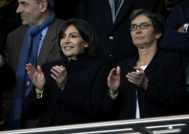 Anne Hidalgo, Paris deputy, and French Minister of Sport Valerie Fourneyron attend the Champions League round of 16 second leg soccer match between Paris St Germain and Bayer Leverkusen at the Parc de