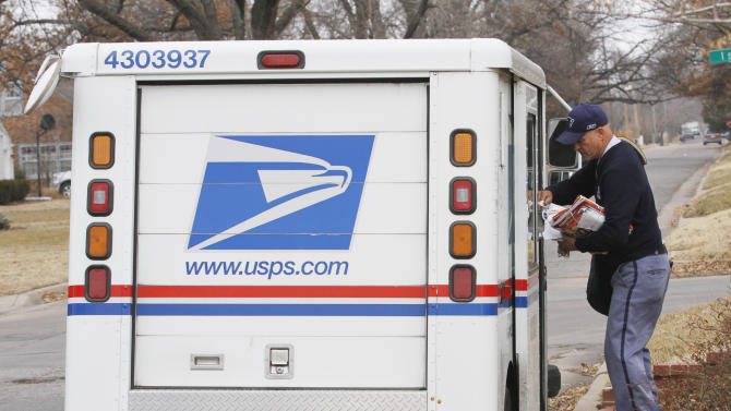 Russ Fox, a letter carrier for the U.S. Postal Service, prepares to deliver mail in Wichita, Kan., Wednesday, Feb. 6, 2013. The U.S. Postal Service will stop delivering mail on Saturdays but continue to deliver packages six days a week under a plan aimed at saving about $2 billion annually, the financially struggling agency says. (AP Photo/The Wichita Eagle, Brian Corn) LOCAL TV OUT; MAGS OUT; LOCAL RADIO OUT; LOCAL INTERNET OUT