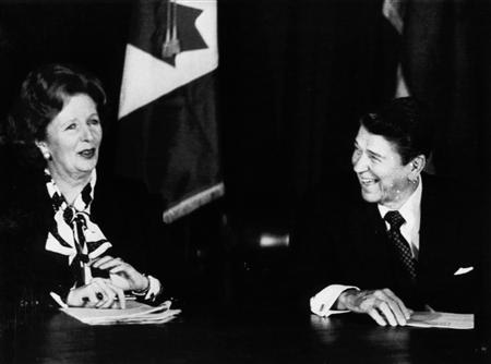 Then British Prime Minister Margaret Thatcher (L) and then U.S. President Ronald Reagan share a laugh during a meeting of the Allied leaders in New York in this October 24, 1985 file photo. REUTERS/Chas Cancellare/Files