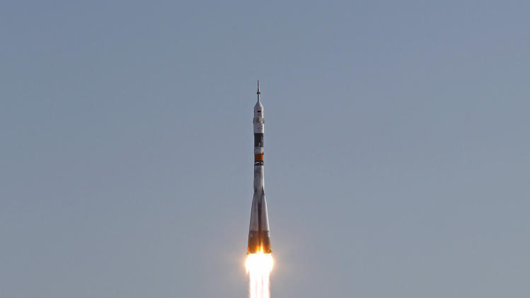 The Soyuz-FG rocket booster with a Soyuz TMA-04M spaceship carrying a new crew to the International Space Station, ISS, blasts off from the Russian leased Baikonur cosmodrome, in Kazakhstan, Tuesday, May 15, 2012. The Russian rocket is carrying U.S. astronaut Joseph Acaba along with Russian cosmonauts Gennady Padalka and Sergei Revin. (AP Photo/Mikhail Metzel)