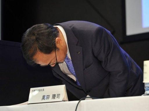 Japan's electronics company Sharp President Takashi Okuda explains the company's huge losses