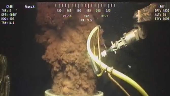 FILE - In this Monday July 12, 2010 image from video made available by BP PLC, oil flows out of the top of the transition spool, which was placed into the gushing wellhead and will house the new containment cap, at the site of the Deepwater Horizon oil spill in the Gulf of Mexico. An April 20, 2010 explosion at the offshore platform killed 11 men, and the subsequent leak released an estimated 172 million gallons of petroleum into the gulf. (AP Photo/BP PLC)