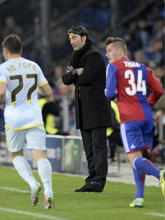 Basel's head coach Murat Yakin watches play during a Champions League group E group stage match between Switzerland's FC Basel 1893 and Romania's FC Steaua Bucharest at the St. Jakob-Park stadium in B