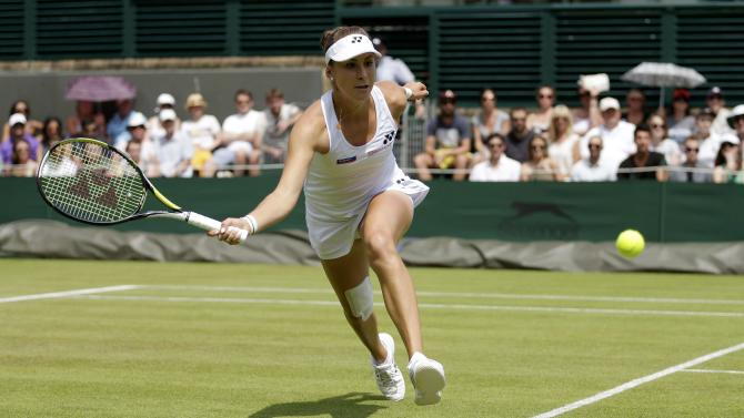 Belinda Bencic of Switzerland hits a shot during her match against Bethanie Mattek-Sands of the U.S.A. at the Wimbledon Tennis Championships in London