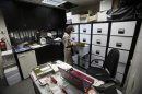 An employee stands in front of a file cabinet at an e-commerce firm in Nablus