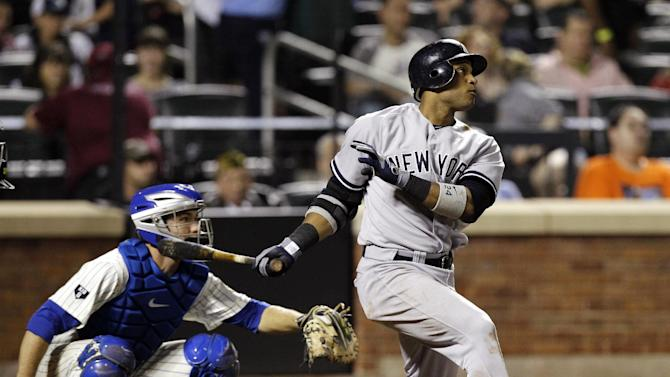 New York Yankees' Robinson Cano follows his seventh-inning, solo-home run off New York Mets relief pitcher Miguel Batista as catcher Josh Thole, left, watches during their interleague baseball game at Citi Field in New York, Sunday, June 24, 2012. (AP Photo/Kathy Willens)