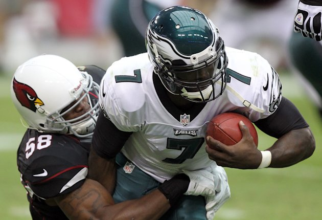Philadelphia Eagles quarterback Michael Vick, right, is sacked by Arizona Cardinals linebacker Daryl Washington, left, in the second quarter of an NFL football game on Sunday, Sept. 23, 2012, in Glendale, Ariz. (AP Photo/Paul Connors)