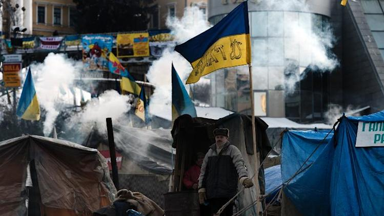 A man stands outside a protest camp in Kiev's Independence Square on February 1, 2014