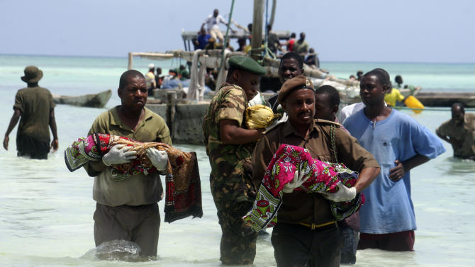 Tanzanian police carry bodies of children from the sea in Zanzibar, Tanzania, Saturday, Sept 10, 2011. An overcrowded ship sank in deep sea off mainland Tanzania on Saturday with about 600 people onboard, and about 370 people are believed missing or dead. (AP Photo/Sultan Ali)