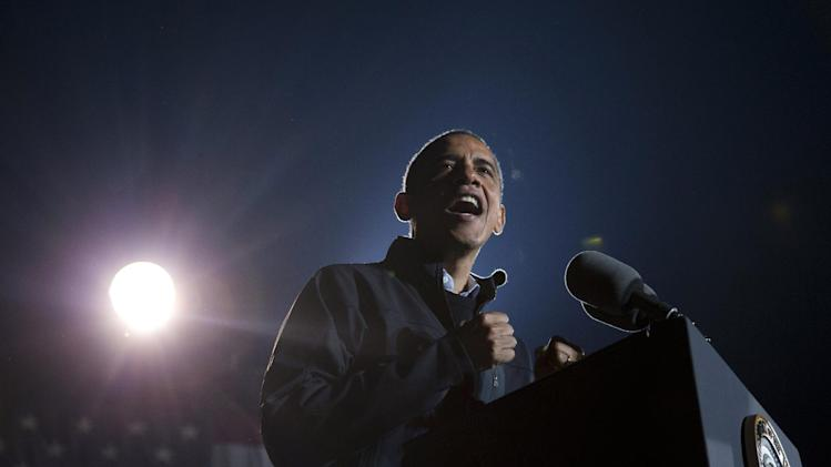 President Barack Obama gestures as he speaks at his final campaign stop on the evening before the 2012 election, Monday, Nov. 5, 2012, in the downtown Des Moines, Iowa. (AP Photo/Carolyn Kaster)