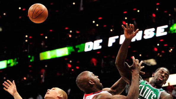 Ivan Johnson #44 of the Atlanta Hawks battles for a rebound with Greg Stiesma #54 and Brandon Bass #30 of the Boston Celtics in Game One of the Eastern Conference Quarterfinals in the 2012 NBA Playoffs on April 29, 2012 at Philips Arena in Atlanta, Georgia. NOTE TO USER: User expressly acknowledges and agrees that, by downloading and or using this photograph, User is consenting to the terms and conditions of the Getty Images License Agreement. (Photo by Grant Halverson/Getty Images)