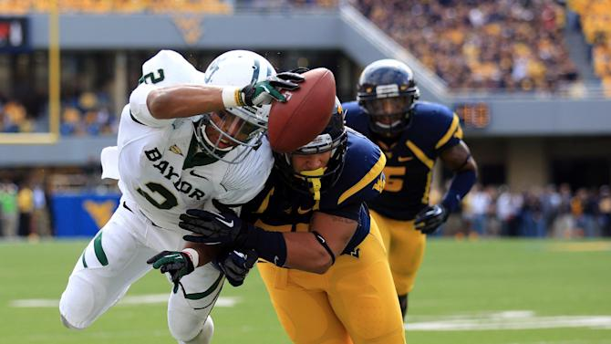 West Virginia's Tyler Anderson (53), right foreground,  tackles Baylor's Terrance Williams (2)  before the goal line during their NCAA college football game in Morgantown, W.Va., Saturday, Sept. 29, 2012. (AP Photo/Christopher Jackson)